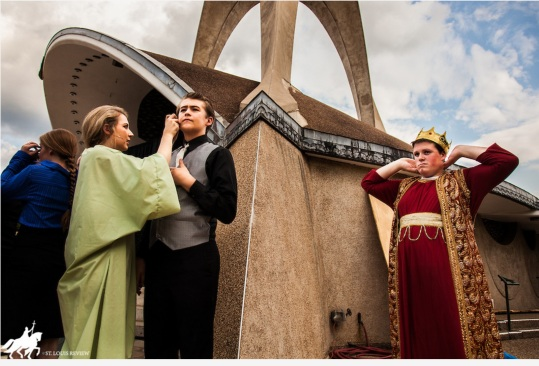 BACKSTAGE AT THE AMPHITHEATRE--Julia Pottinger (Ella/Esther) assists Zach Thompson (Harry/Hegai) with his microphone before the premiere of 'Just Pretend'. Collin Borisenko (Zeke/Xerxes) scans the crowd of over a thousand in attendance on a cool summer night.
